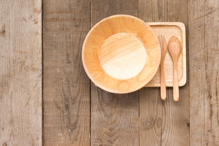 Set of wooden Kitchenware handmade vintage on wooden top view (fork, spoon, bowl, plate)