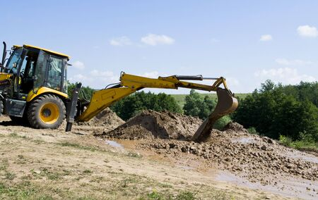 digging: excavator digging Stock Photo
