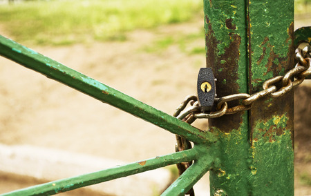 keep gate closed: lock with a chain on the gate