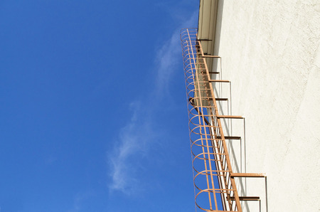 lowrise: vertical metal fire ladder for low-rise buildings Stock Photo