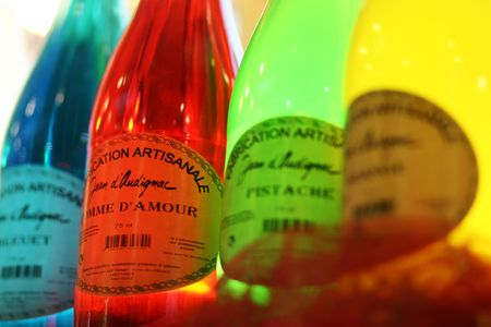 Four bright versicolored bottles  Stock Photo