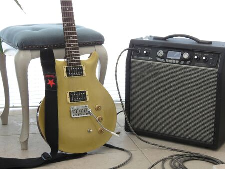 amplifier: gold top electric guitar and amplifier shining on a daylight