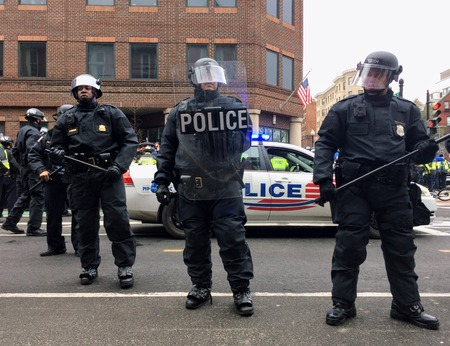 WASHINGTON, Jan. 20, 2017 -- Police in riot gear surround detained DisruptJ20 protesters during the presidential inauguration of Donald Trump, resulting in a mass arrest and felony rioting charges. Editorial