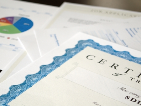 Certificate and Business Documents laid out on a dark table  photo
