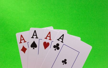 Four Aces on a Green Background Stock Photo