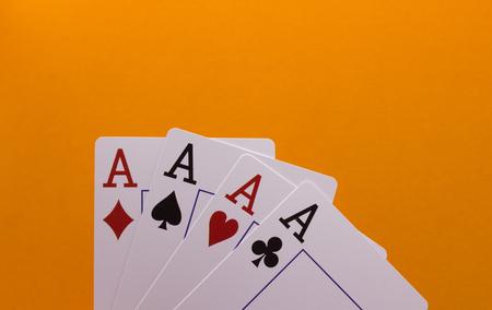 Four Aces on an Orange Background Stock Photo