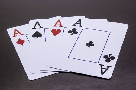 Four Aces on a dark background Stock Photo