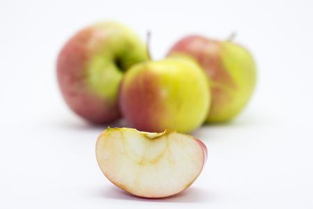 Apple slice on the background of three apples