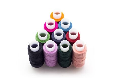 Colored thread on white background, sewing