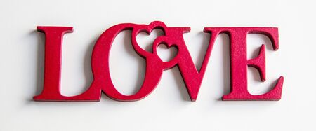 The word love is written in a wooden letter on the background.