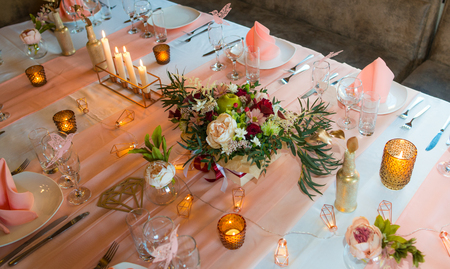 A table covered with cutlery. Wedding decorations.