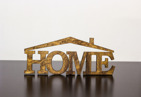The word home is made of wood on a dark table Stock Photo