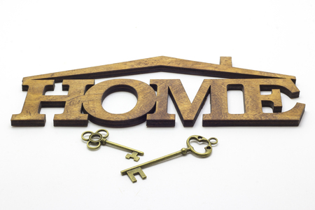 The word House is made of wood with gold key.