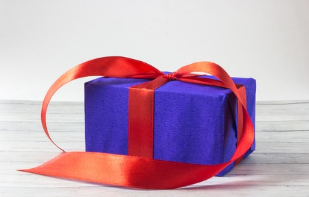 Gift boxes over wooden background close up