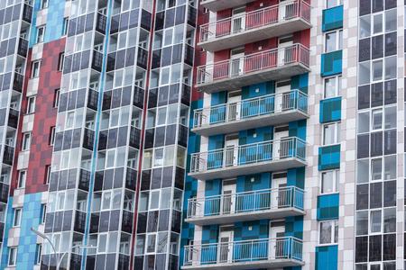Facade of a multi-storey building. Fragment. Stok Fotoğraf