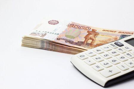 Lots of Money and a close-up calculator Фото со стока
