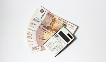 Lots of Money and a close-up calculator Stock Photo