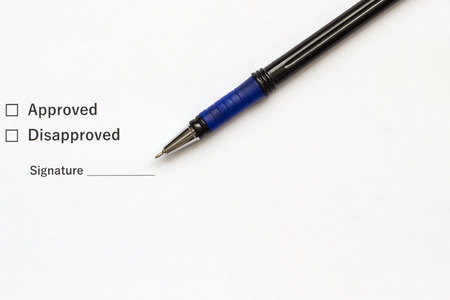 Document with a place for a signature and a pen closeup