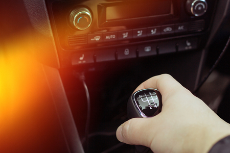 manual transmission gear shift, and man hand