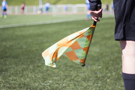 A football referee follows the game on the football field Stock Photo