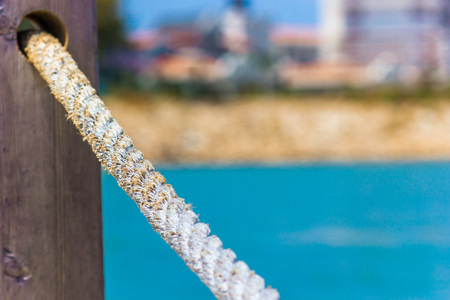 Rope handrails made of rope against the blue sea, close-up