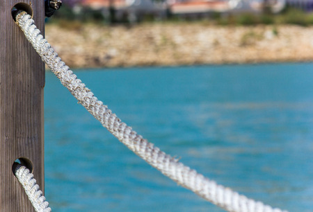 Rope handrails made of rope against the blue sea Banco de Imagens