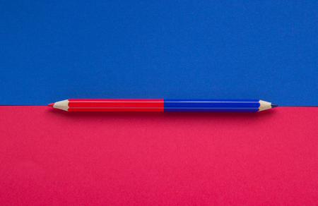 Close-up of a red blue pencil on a background, concept of education