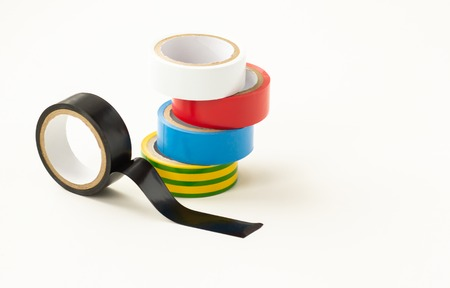 Close-up. Multicolored insulating tape on a white background.