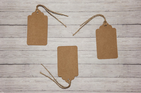 Several price tags on a wooden background, the concept of sales Stock fotó