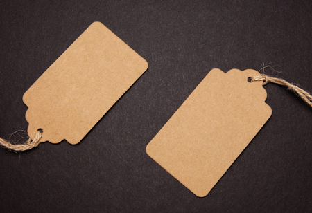Close-up, two price tags on black background