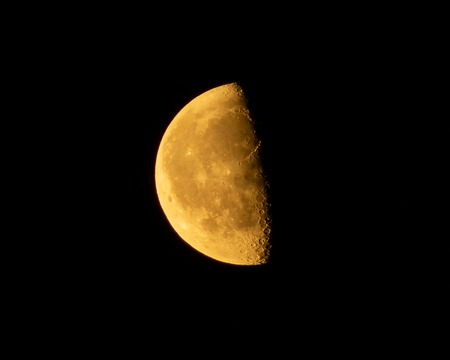 Half Moon background, the Moon is an astronomical body that orbits planet Earth, close-up