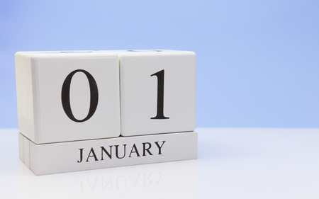 January 01st. Day 01 of month, daily calendar on white table with reflection, with light blue background. Winter time, empty space for text Stock Photo - 116773642