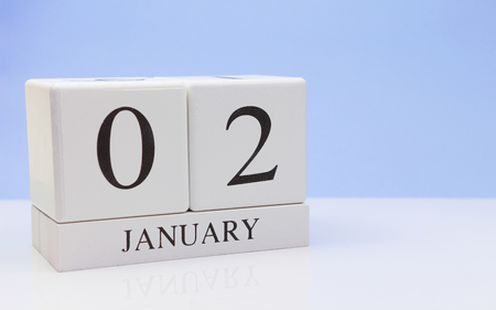 January 02st. Day 02 of month, daily calendar on white table with reflection, with light blue background. Winter time, empty space for text Stock Photo - 116773643