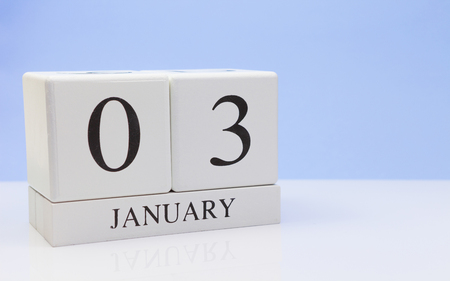 January 03st. Day 03 of month, daily calendar on white table with reflection, with light blue background. Winter time, empty space for text