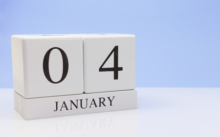 January 04st. Day 04 of month, daily calendar on white table with reflection, with light blue background. Winter time, empty space for text Stock Photo