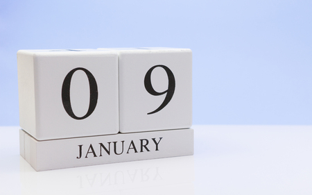 January 09st. Day 09 of month, daily calendar on white table with reflection, with light blue background. Winter time, empty space for text