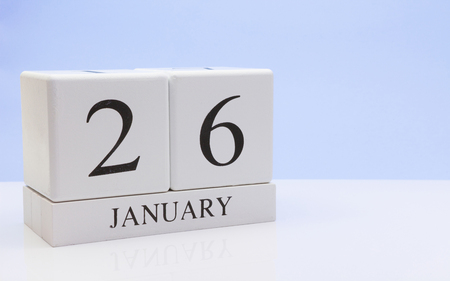 January 26st. Day 26 of month, daily calendar on white table with reflection, with light blue background. Winter time, empty space for text Stock Photo