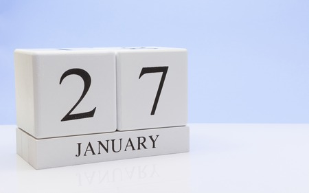 January 27st. Day 27 of month, daily calendar on white table with reflection, with light blue background. Winter time, empty space for text Stock Photo - 116773746