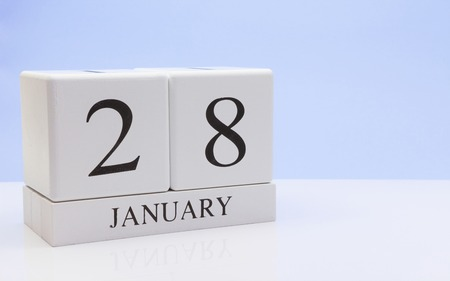 January 28st. Day 28 of month, daily calendar on white table with reflection, with light blue background. Winter time, empty space for text Stock Photo - 116773767