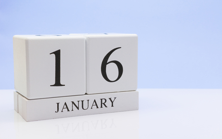 January 16st. Day 16 of month, daily calendar on white table with reflection, with light blue background. Winter time, empty space for text Stock Photo