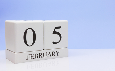 February 05st. Day 05 of month, daily calendar on white table with reflection, with light blue background. Winter time, empty space for text Stock Photo