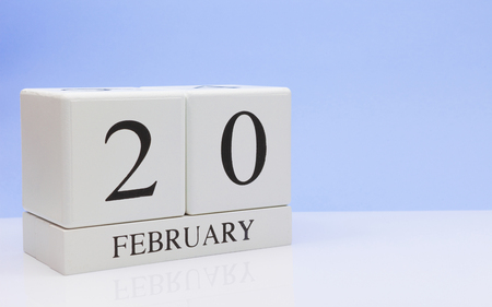 February 20st. Day 20 of month, daily calendar on white table with reflection, with light blue background. Winter time, empty space for text Stock Photo