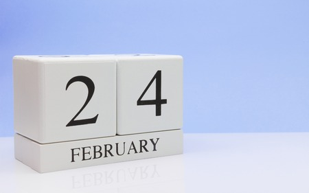 February 24st. Day 24 of month, daily calendar on white table with reflection, with light blue background. Winter time, empty space for text Stock Photo