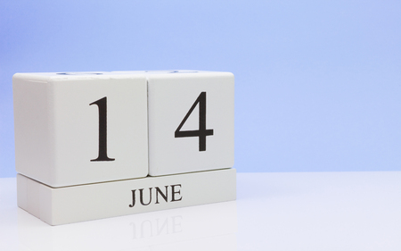 June 14st. Day 14 of month, daily calendar on white table with reflection, with light blue background. Summer time, empty space for text