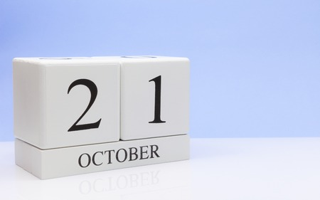 October 21st. Day 21 of month, daily calendar on white table with reflection, with light blue background. Autumn time, empty space for text Фото со стока