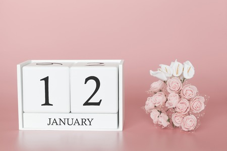 January 12th. Day 12 of month. Calendar cube on modern pink background, concept of bussines and an importent event. Banco de Imagens