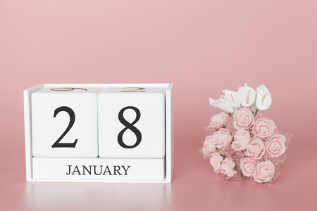 January 28th. Day 28 of month. Calendar cube on modern pink background, concept of bussines and an importent event.
