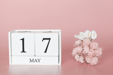 May 17th. Day 17 of month. Calendar cube on modern pink background, concept of bussines and an importent event.