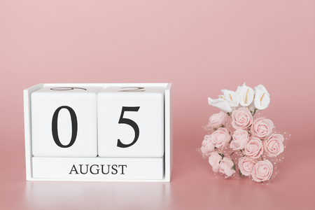 August 05th. Day 5 of month. Calendar cube on modern pink background, concept of bussines and an importent event.
