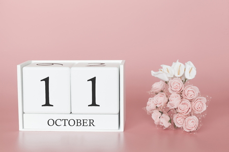 October 11th. Day 11 of month. Calendar cube on modern pink background, concept of bussines and an importent event.